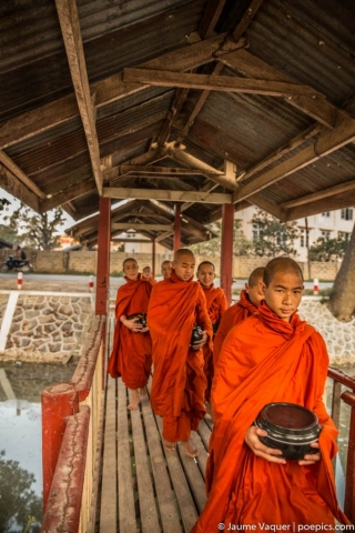 Budhist novice monks in a monastery after collecting alms, Inle Lake, Myanmar (Burma)